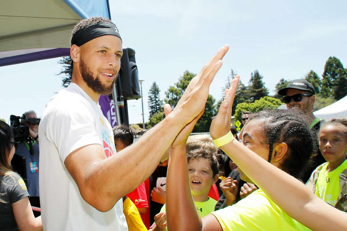 OAKLAND, CALIFORNIA - JULY 18: Stephen Curry greets kids at the launch of Eat. Learn. Play. Foundation on July 18, 2019 in Oakland, California. (Photo by Kimberly White/Getty Images)