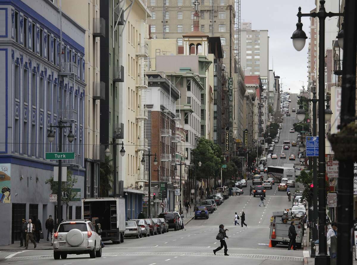 In this Feb. 15, 2011, file photo, shown is a view looking up Taylor Street of the Tenderloin neighborhood in San Francisco.