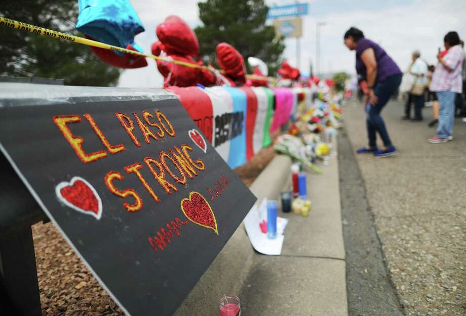 "A message reads ""El Paso Strong"" at a makeshift memorial for victims outside Walmart, near the scene of a mass shooting which left at least 22 people dead, on Aug. 6 in El Paso. Photo: Mario Tama /Getty Images / 2019 Getty Images"