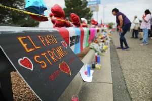 """A message reads """"El Paso Strong"""" at a makeshift memorial for victims outside Walmart, near the scene of a mass shooting which left at least 22 people dead, on Aug. 6 in El Paso."""