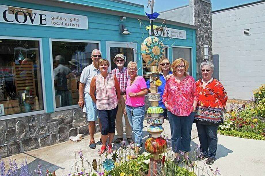 Local artists, left to right, Rich Yaroch, Alice Yaroch, Dave Thuemmel, Lynne Wiencek, Laurie Conger, Deb Maxwell and Jeanette Ziel, were involved in the art totem project in Port Austin. (Bill Diller/For the Tribune)
