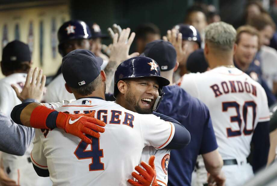 Houston Astros Yuli Gurriel (10) celebrates with George Springer (4) after hitting a three-run home run off of Colorado Rockies starting pitcher Peter Lambert during the first inning of an MLB baseball game at Minute Maid Park, Wednesday, August 7, 2019. Photo: Karen Warren/Staff Photographer