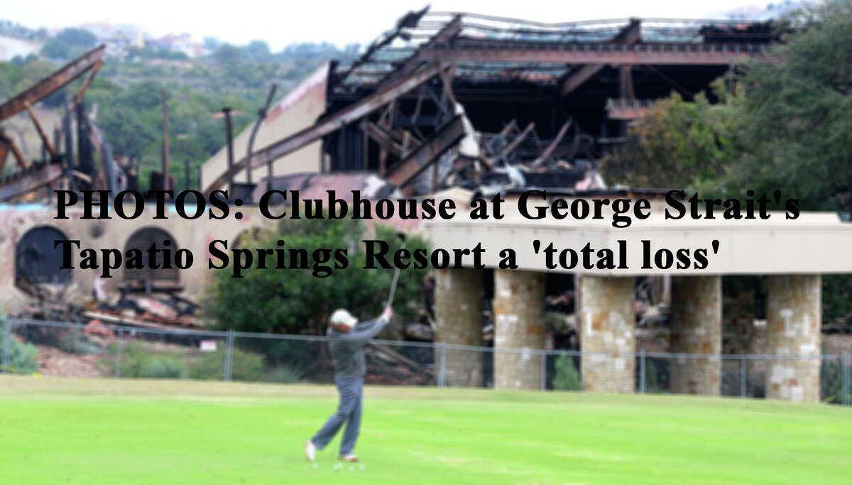 A man golfs in front of the burned club house at the Tapatio Springs Hill Country resort near Boerne, Texas. A fire destroyed the building Saturday night November 4, 2017. Tapatio Springs is on 220 acres in the Hill Country. Its 18-hole golf course recently underwent a $2 million renovation. One of its owners is country music star George Strait.