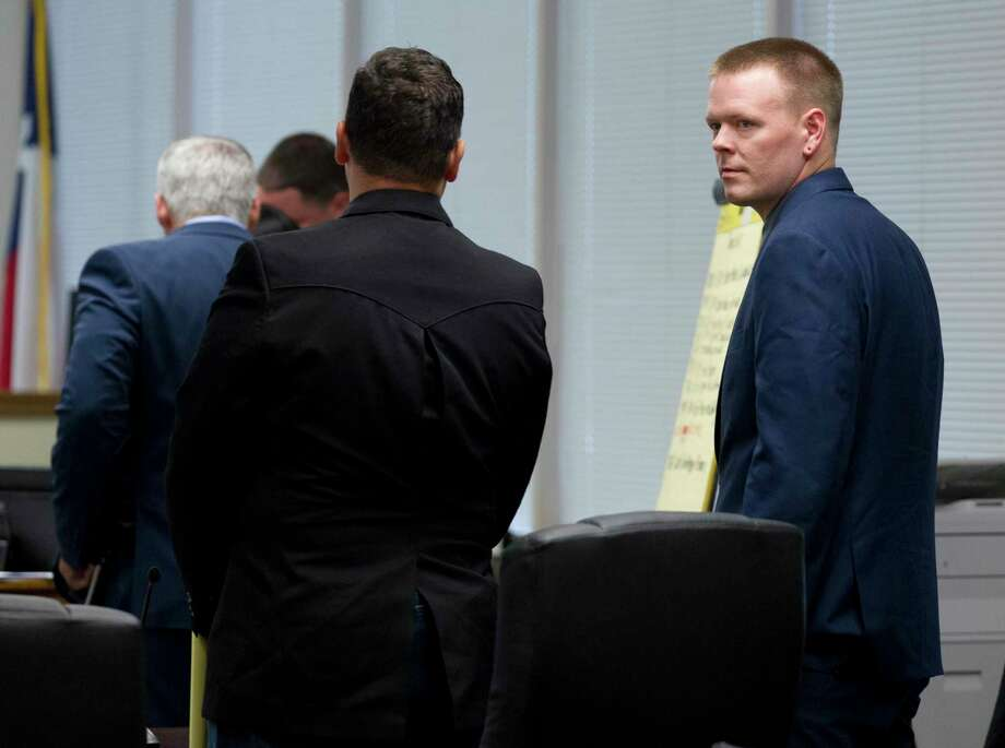Former Willis Police Officer John McCaffery, right, is seen beside Kenneth Elmore during a trial in the courtroom of 221st state District Court Judge Lisa Michalk at Lee G. Alworth Building, Tuesday, Aug. 6, 2019, Conroe. McCaffery and Elmore were indicted by a grand jury in July 2018 and changed with official oppression, a Class A misdemeanor, and a second charge of tampering with a governmental record, a state jail felony, in connection with a tazing incident involving Willis resident Kendric Kizzie on July 29, 2017. Photo: Jason Fochtman, Houston Chronicle / Staff Photographer / Houston Chronicle