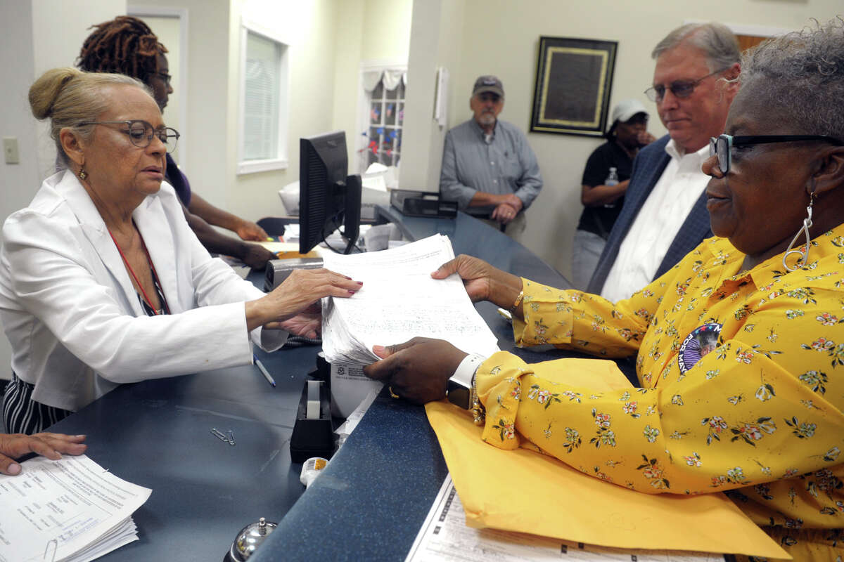 State Sen. Marilyn Moore presents primary petitions to Santa Ayala, the Democratic Registrar of Voters in Bridgeport, Conn. Aug. 7. 2019. Moore hopes to make it onto September's Democratic Primary for Mayor.