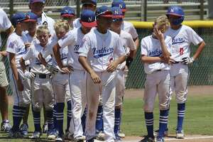Texas West players stand on the field after their loss to Louisiana 6-2 following the Southwestern Little League baseball regional championship game, Wednesday, Aug. 7, 2019, in Waco, Texas. (Rod Aydelotte/Waco Tribune-Herald via AP)