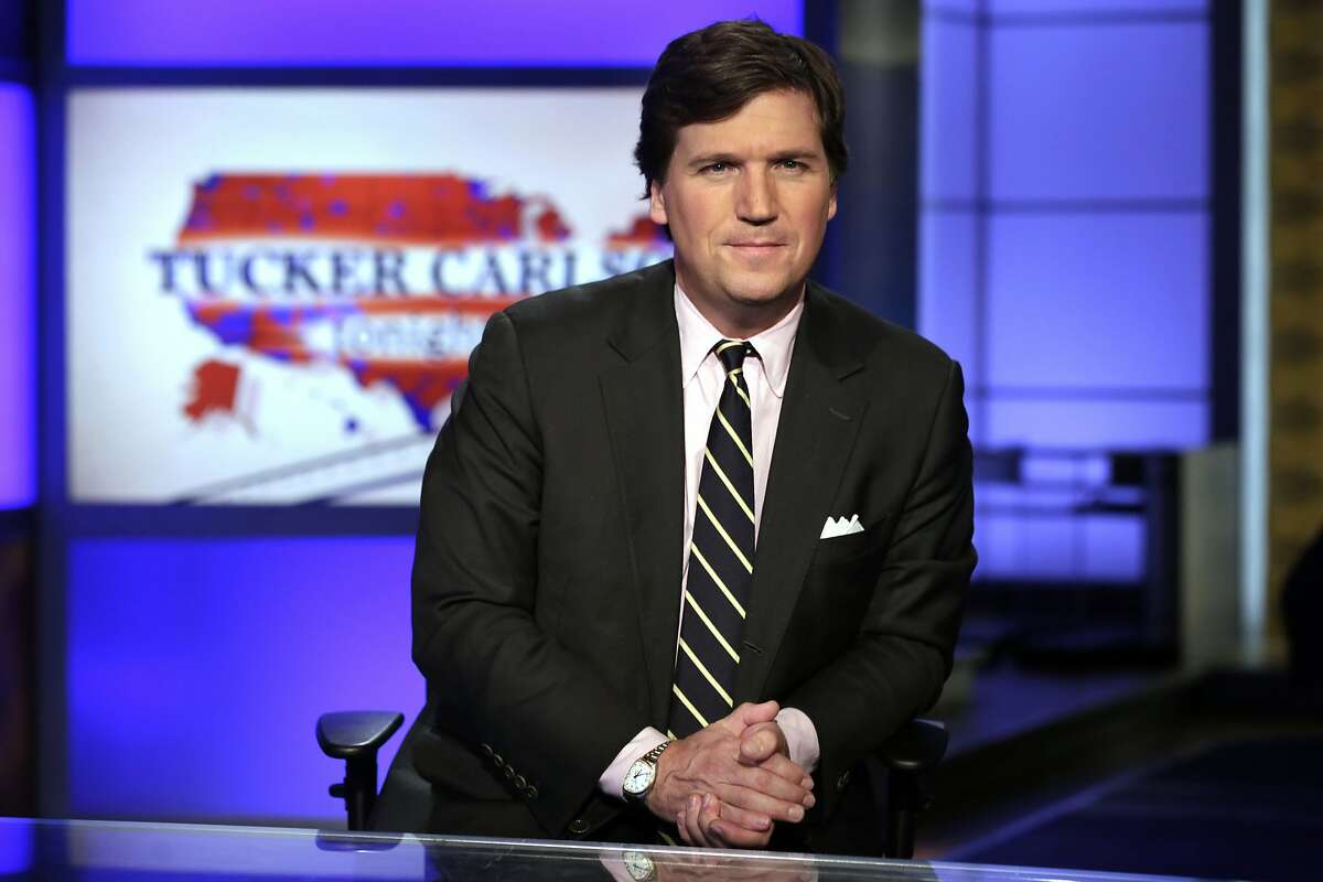 """FILE - In this March 2, 2017 file photo, Tucker Carlson, host of """"Tucker Carlson Tonight,"""" poses for photos in a Fox News Channel studio, in New York."""