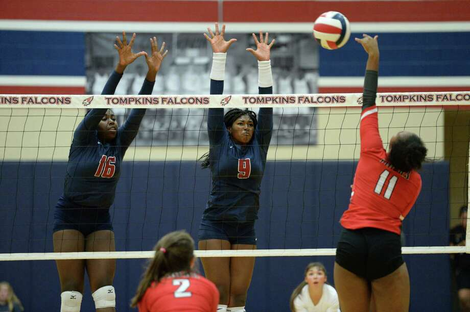 Natissia Baptiste (16) and Tendai Titley (9) of Tompkins try to block a shot during the second set of a volleyball match between the Tompkins Falcons and the Travis Tigers on Tuesday, August 6, 2019 at the Travis HS, Katy, TX. Photo: Craig Moseley, Staff / Staff Photographer / ©2018 Houston Chronicle
