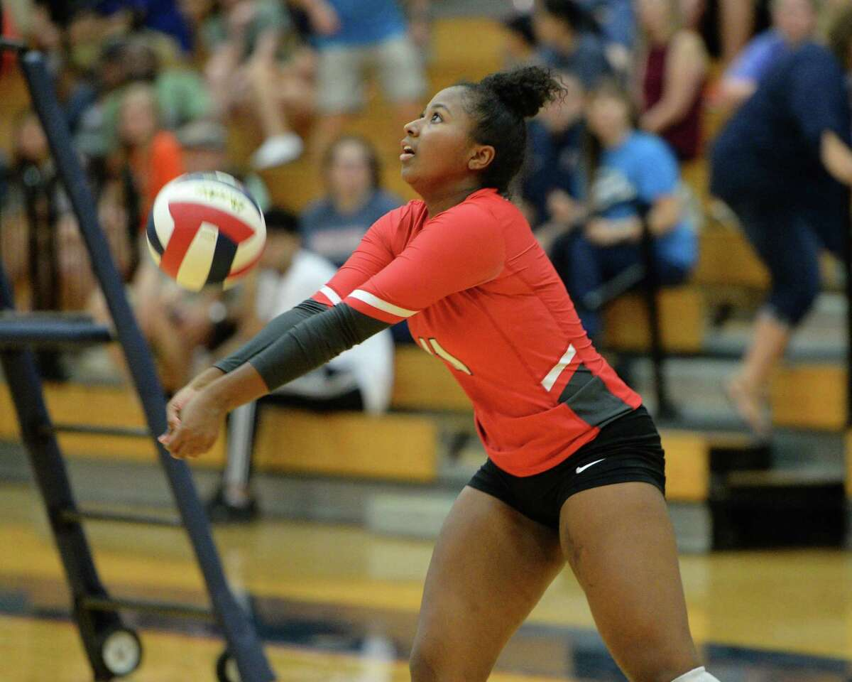 Brianna McDonald (11) of Travis digs for a ball during the second set of a volleyball match between the Tompkins Falcons and the Travis Tigers on Tuesday, August 6, 2019 at the Travis HS, Katy, TX.