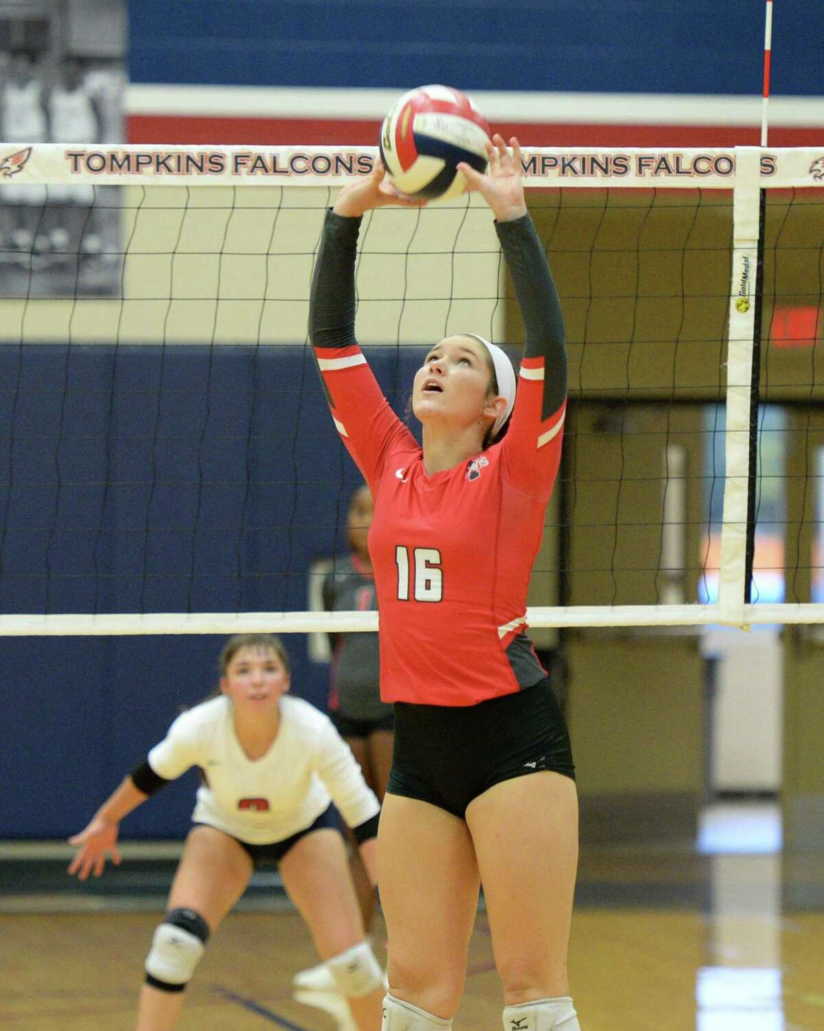 Anna Kate Glath (16) of Travis sets a ball during the second set of a volleyball match between the Tompkins Falcons and the Travis Tigers on Tuesday, August 6, 2019 at the Travis HS, Katy, TX.