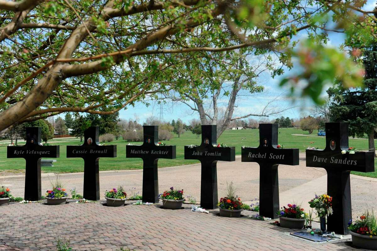 Crosses with the names and portraits of the victims of the 1999 Columbine High School massacre are seen at Chapel Hill Memorial Gardens in Littleton, Colorado.