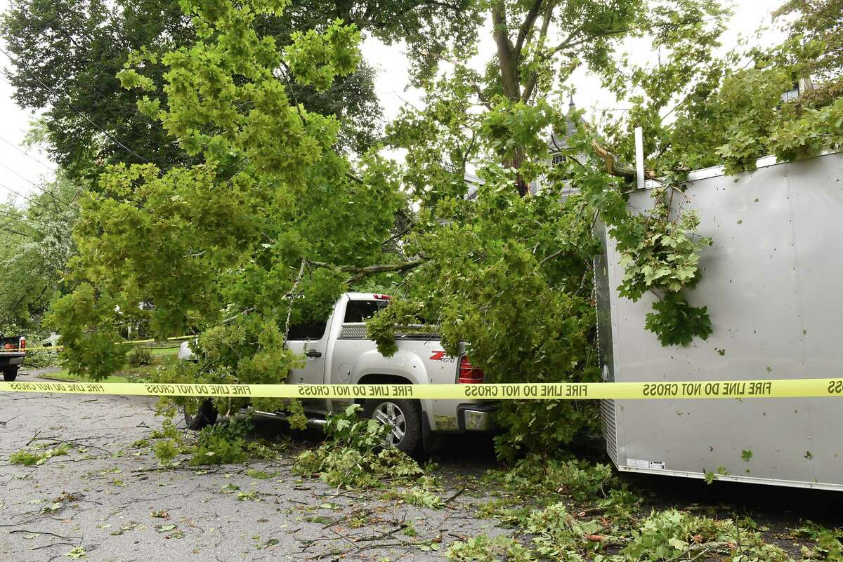 Part of a tree fell on the truck and trailer of contractor Steve Hipwell of East Greenbush on Maple Ave. during a bad storm on Wednesday, Aug. 7, 2019 in Troy, N.Y. Hipwell was working on a clients home when the storm hit. The road was closed at one end. (Lori Van Buren/Times Union)