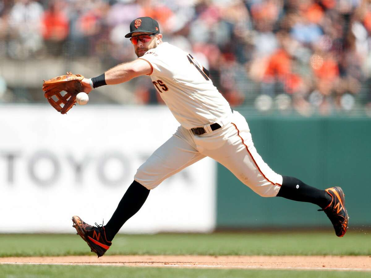 San Francisco Giants' Evan Longoria fields a grounder off the bat of Washington Nationals' Trea Turner in 4th inning during MLB game at Oracle Park in San Francisco, Calif., on Wednesday, August 7, 2019. Turner would beat Longoria's throw to first for an infield hit.