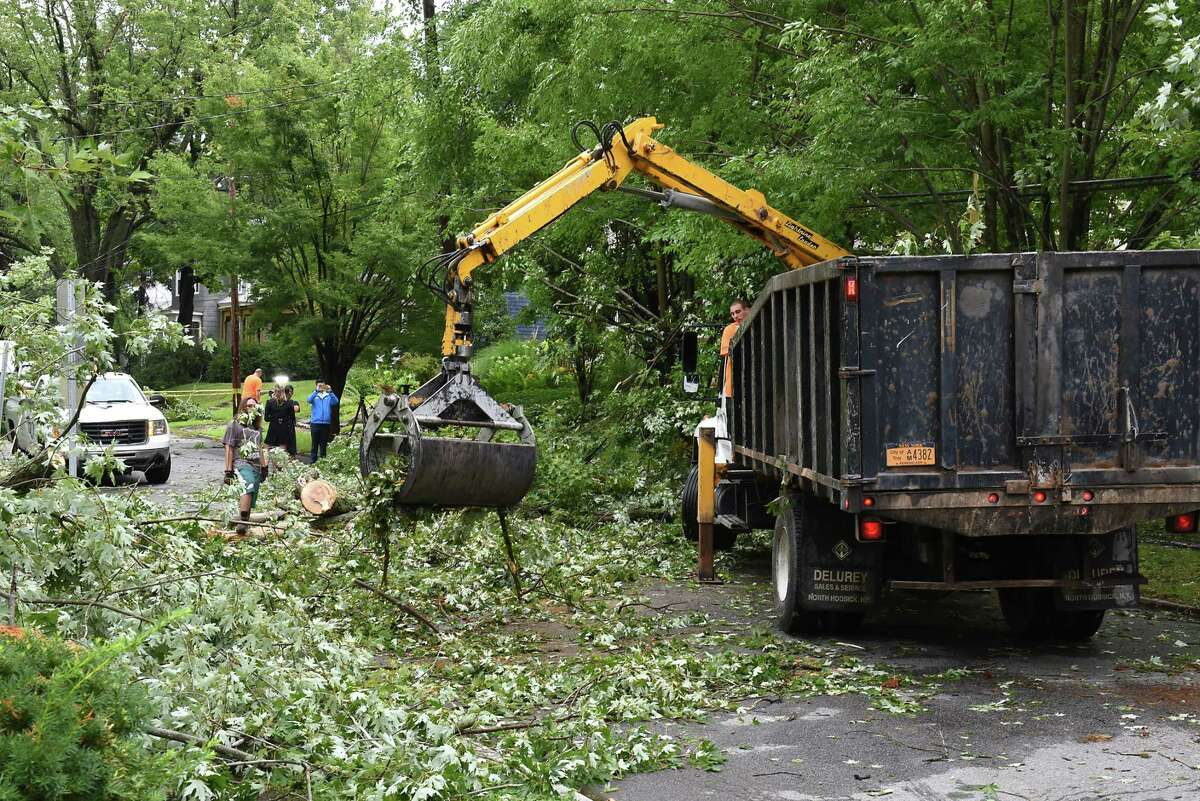 Fallen trees and debris are removed from Maple Ave. by Troy Bureau of Streets crew on Wednesday, Aug. 7, 2019 in Troy, N.Y. The road was closed at one end. (Lori Van Buren/Times Union)