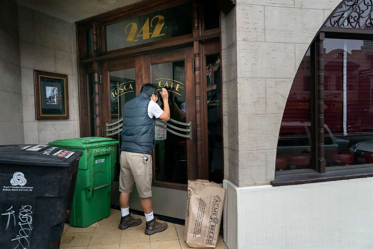 Tenzin Tarasamba attempts to deliver bread to North Beach's 100-year-old Tosca Cafe on Monday, July 29, 2019, in San Francisco, CA.