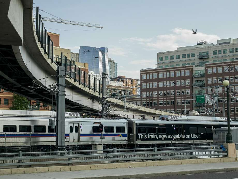 A G line Regional Transportation District train features an Uber advertisement in Denver, where riders of the public transit system can use Uber to buy tickets. Photo: Photos By Terry Ratzlaff / New York Times