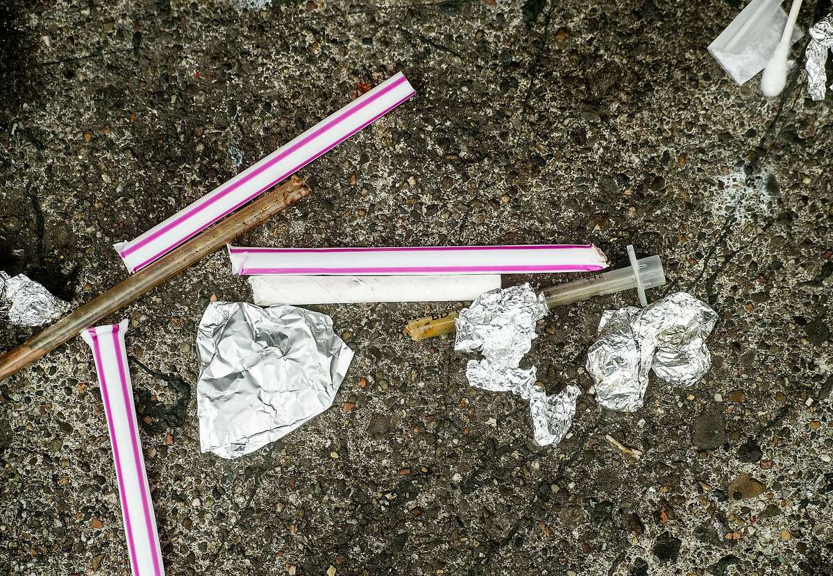 Drug paraphernalia removed from a woman's bag rests on Hyde St. following an arrest on Wednesday, Aug. 7, 2019, in San Francisco.