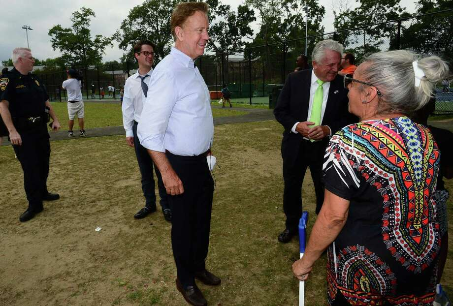 """Norwalk Mayor Harry Rilling accompanies Connecticut Governor Ned Lamont in his """"Day in the Life"""" tour of Roodner Court Housing Complex, the Grassroots Tennis facility and other areas of the city Wednesday, August 7, 2019, in Norwalk, Conn. Photo: Erik Trautmann / Hearst Connecticut Media / Norwalk Hour"""