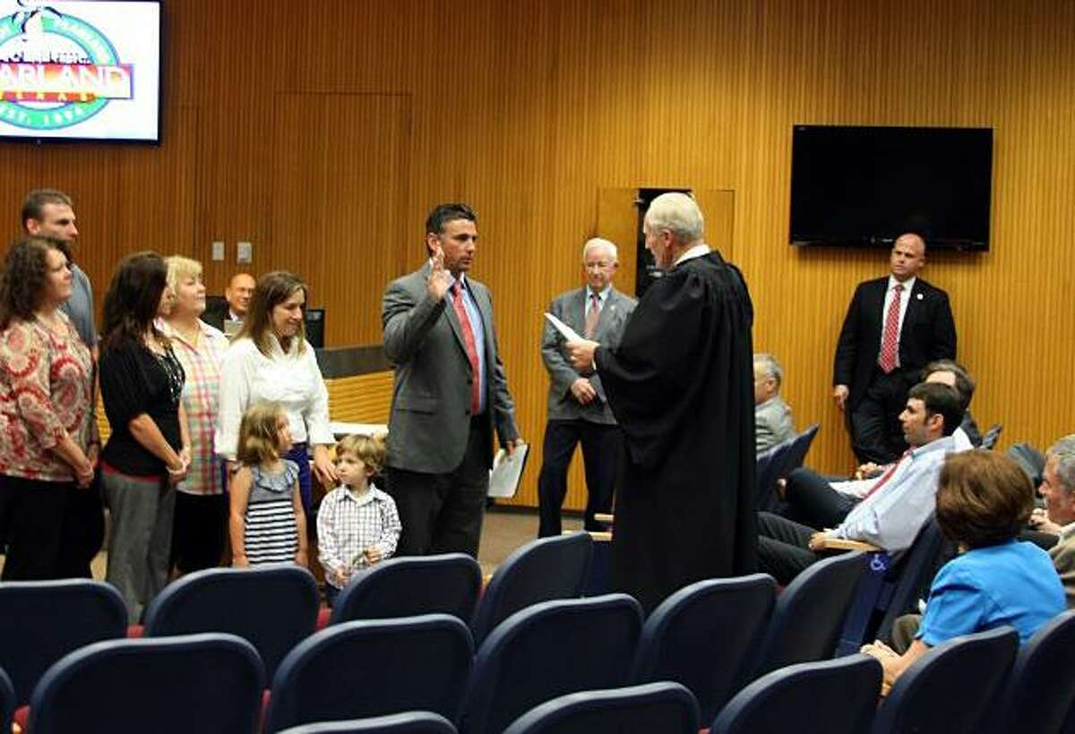 Greg Hill, a former Pearland City Council member, being sworn into office in 2013. Hill, now a County Court-at-Law judge, is the first Republican to announce he'll seek to represent the 22nd Congressional District seat that will be vacated by U.S. Rep. Pete Olson.