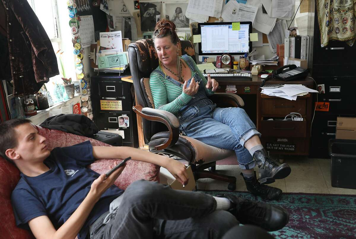 Director Jenny Friedenbach (top middle) of Coalition on Homeless talks with Our City Our Home researcher Anubis Daugherty in the office on Monday, Aug. 5, 2019, in San Francisco, Calif. Coalition on Homeless have lost their lease and have to move by October.