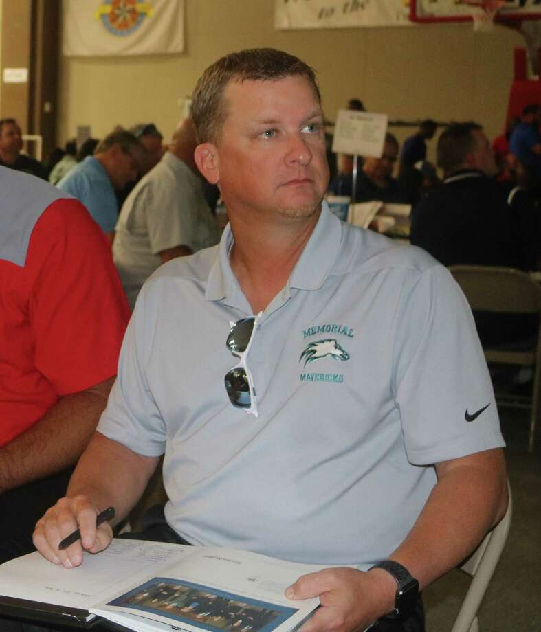 New Memorial head football coach James Crocker, studying the list of officials at last month's referee selection meeting, formally opened fall drills this week. Photo: Robert Avery