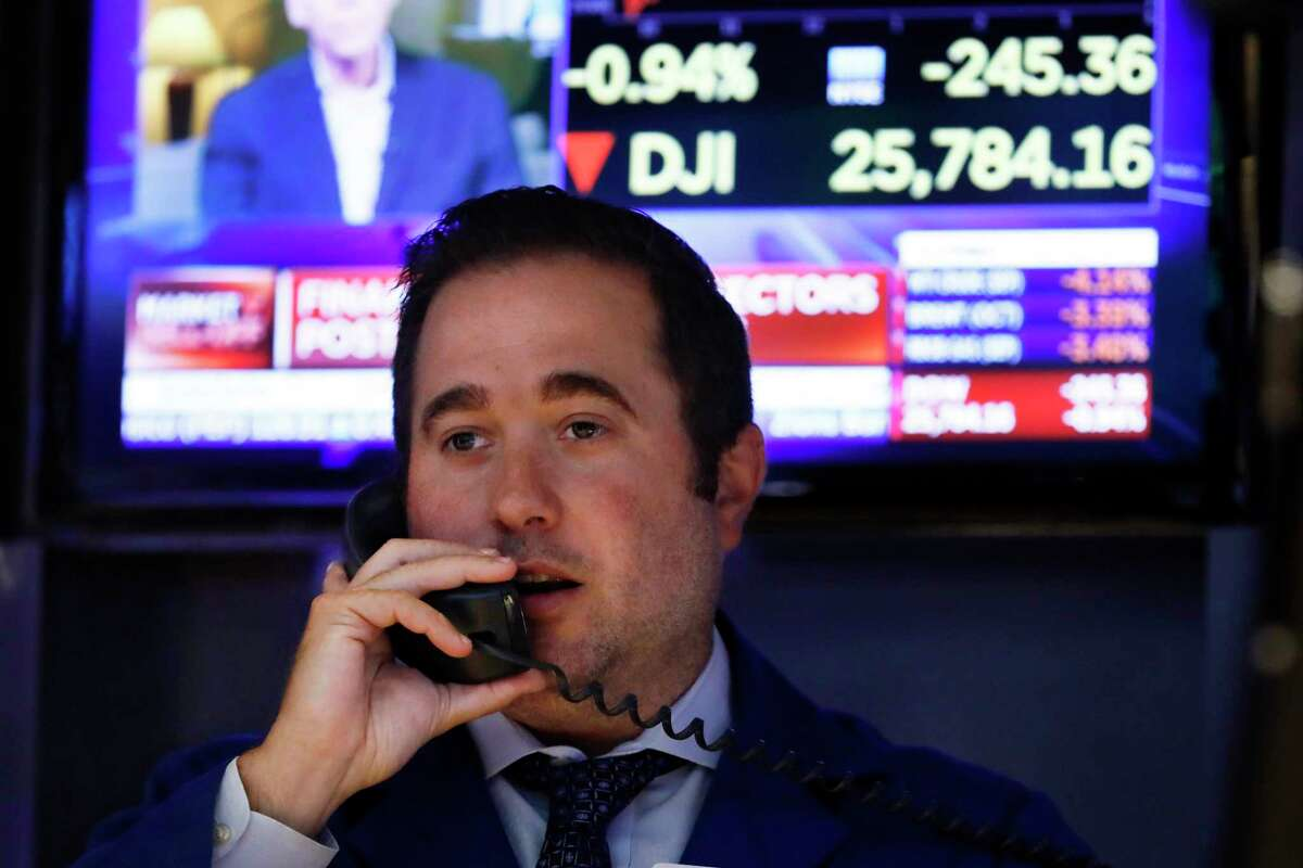 Specialist Gennaro Saporito works on the floor of the New York Stock Exchange, Wednesday, Aug. 7, 2019. U.S. stocks fell broadly in midday trading Wednesday as central banks around the world cut interest rates and increased fears that global growth is being crimped by the U.S.-China trade war. (AP Photo/Richard Drew)