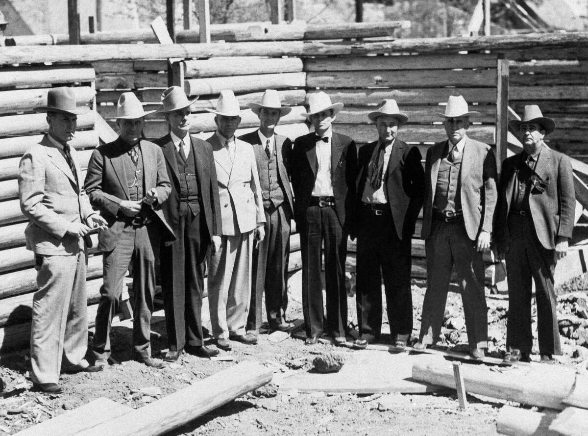 """Members of the Texas Rangers attending the Texas Centennial Exposition in Dallas, Texas on April 9, 1936, are left to right : Capt. Bill McMurray, Ranger Dan Hines, Capt. R. W. Aldrich, Senior Capt. J. W. McCormick, Capt. F. L. McDaniel, Ranger Dick Oldham, Ranger John Gregory, Capt. R. C. """"Red"""" Hawkins and Sgt. John England."""