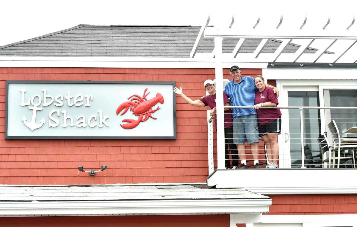 Arlene Crismale, left, and Nick Crismale, the husband and wife co-owners of the Lobster Shack, and daughter-in-law and manager Lisa Crismale, right, on the second-floor deck dining area at the new East Haven location. The Lobster Shack is opening Friday.