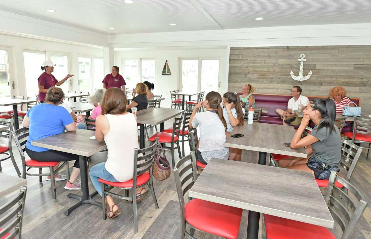 Arlene Crismale, co-owner of the Lobster Shack, left at the new East Haven location with her staff preparing for its opening on Friday.