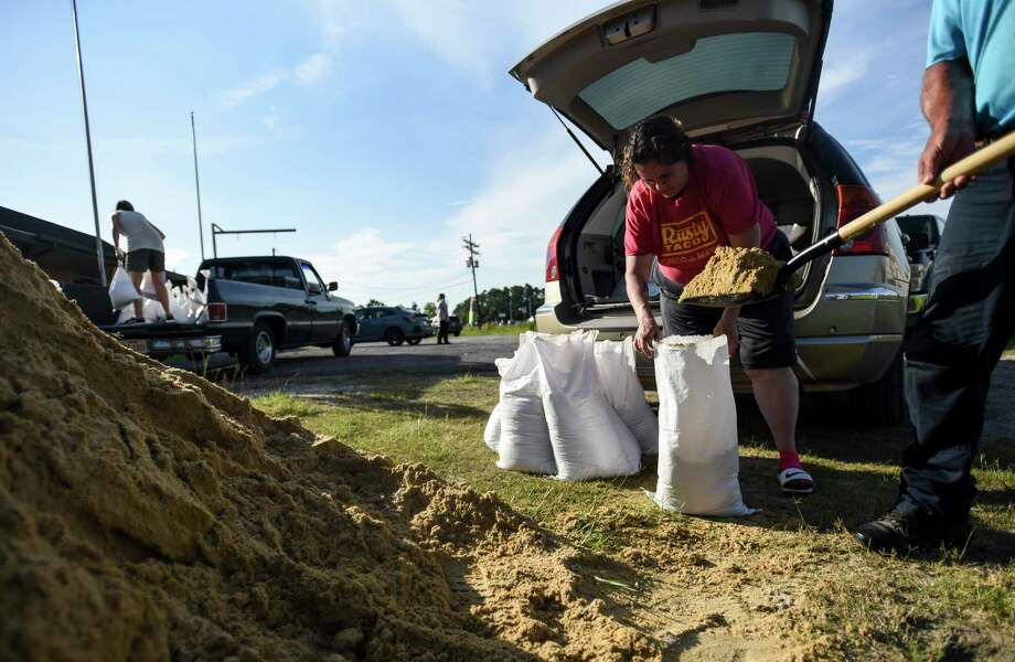 Beanita Netterville, who was affected by Harvey, is helped by Billy Cobb fill sandbags at 11897 State Hwy 62 in Mauriceville Tuesday evening. This was Netterville's third trip to get sandbags for her house. The sandbags and sand were being provided by Orange County and are available to residence at four different locations. Photo taken on Wednesday, 07/10/19. Ryan Welch/The Enterprise Photo: Ryan Welch, Beuamont Enterprise / The Enterprise / © 2019 Beaumont Enterprise