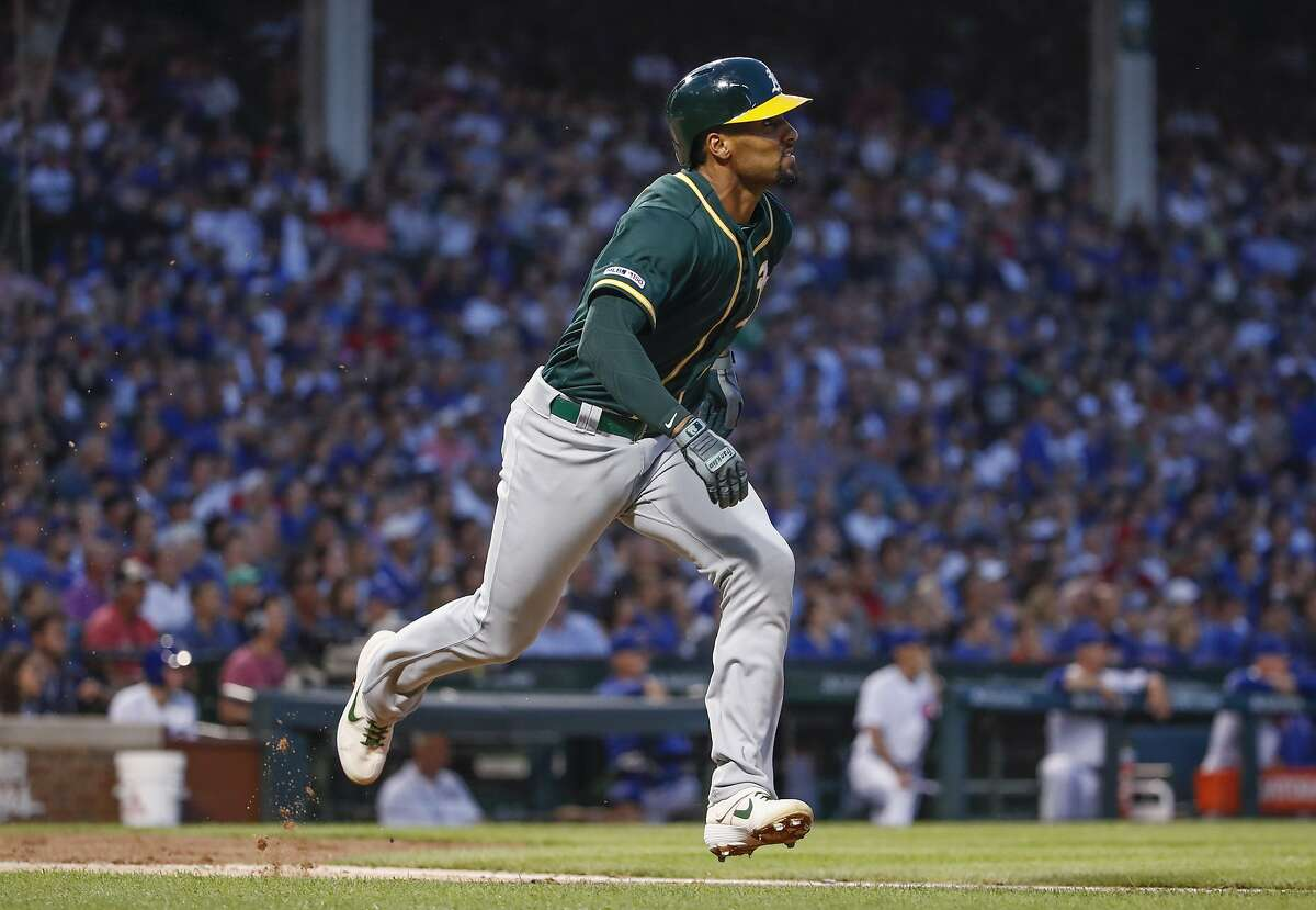 Oakland Athletics' Marcus Semien rounds the bases after hitting two-run home run against the Chicago Cubs during the third inning of a baseball game, Monday, Aug. 5, 2019, in Chicago. (AP Photo/Kamil Krzaczynski)
