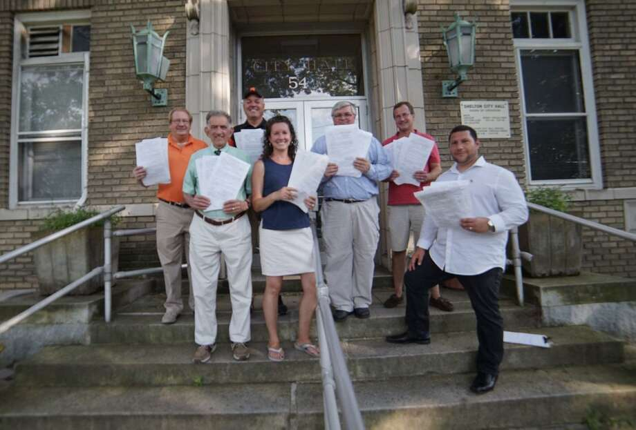 Republicans, left to right, Mark Holden, Tom Minotti, Chris Jones, Anne Gaydos, Greg Tetro, Mike Gaydos and Peter Squitieri submitted their petition signatures to the registrar of voters Wednesday, Aug. 7, to force a primary on Sept. 10. Holden, Minotti and Anne Gaydos seek to be on the Board of Education Republican ticket come November, while Jones is for Planning & Zoning, Mike Gaydos is aldermen second ward, and Tetro and Squitieri are aldermen third ward. Photo: Contributed Photo / Connecticut Post