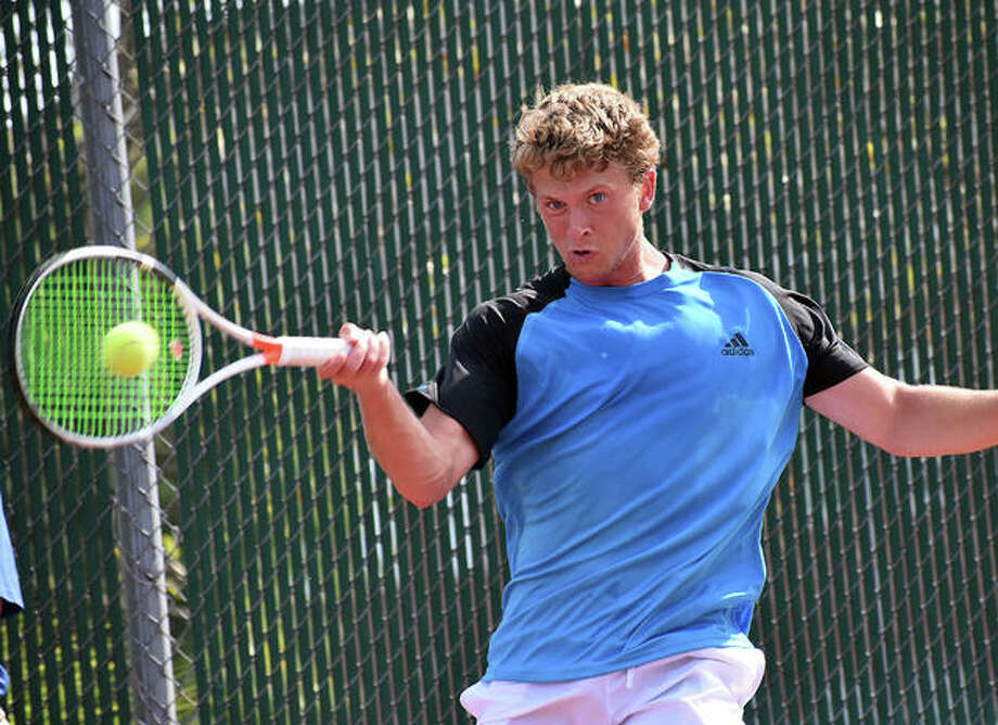 Carson Haskins hits a forehand shot during the first set of his first-round match against Alan Kohen in the Edwardsville Futures on Wednesday at the EHS Tennis Center. Photo: Matt Kamp|The Intelligencer