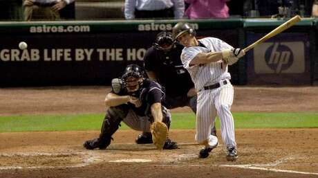 Houston Astros Craig Biggio slaps the 3,000th hit of his career to the opposite field off Colorado Rockies starter Aaron Cook during the seventh inning Thursday, June 28, 2007, at Minute Maid Park in Houston. ( Brett Coomer / Chronicle )