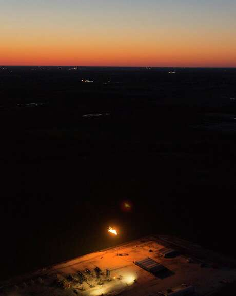 An oil production flares also called a flare stack, is seen in a Wednesday, May 14, 2014 aerial image taken near Karnes City, Texas.