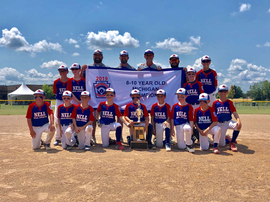 Members of the Northeast team pose with their Little League Baseball minor state championship banner. Photo: Photo Provided