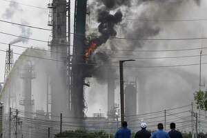Flames and smoke rise after a fire started at an Exxon Mobil facility, Wednesday, July 31, 2019, in Baytown, Texas (Jon Shapley/Houston Chronicle via AP)