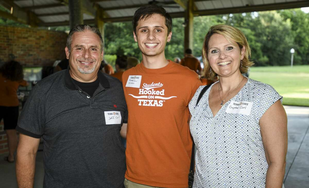 Jeff, Brandon and Crystal Curl pose for a photo during Texas Exes Southeast Chapter meeting. Alumni of University of Texas at Austin were also sending off new students. Photo taken on Wednesday, 8/7/19. Ryan Welch/The Enterprise