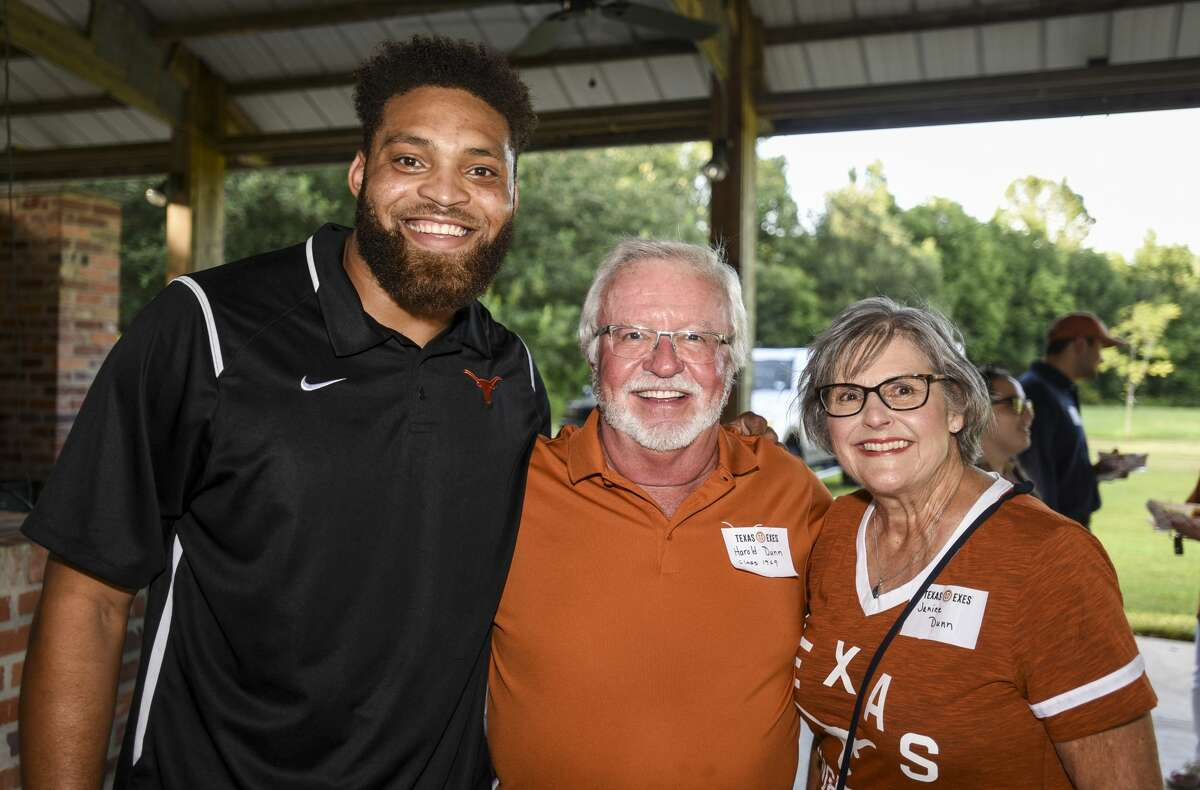 People poses for a photo during Texas Exes Southeast Chapter meeting. Alumni of University of Texas at Austin were also sending off new students. Photo taken on Wednesday, 8/7/19. Ryan Welch/The Enterprise
