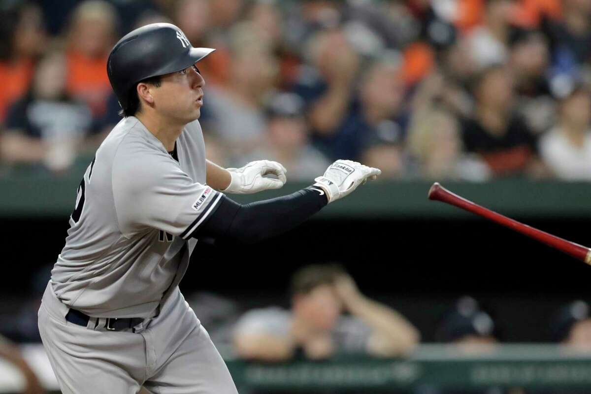 New York Yankees' Kyle Higashioka watches his three-run home run off Baltimore Orioles starting pitcher John Means during the fourth inning of a baseball game Wednesday, Aug. 7, 2019, in Baltimore. (AP Photo/Julio Cortez)
