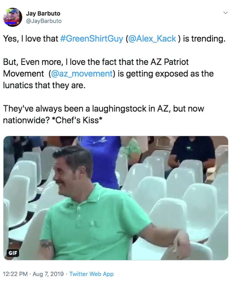 A meme featuring a guy wearing a green shirt and laughing at anti-immigration protestors has gone viral. Photo: Twitter Screenshot
