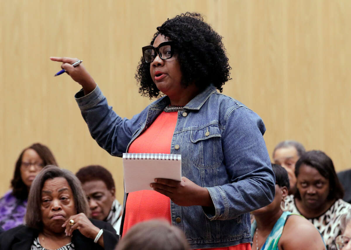 Area resident Ruby Glass asks questions during a public meeting and panel discussion about the proposed concrete batch plant with various city and state agency representatives on Monday, Jul. 22, 2019 in Houston, TX.
