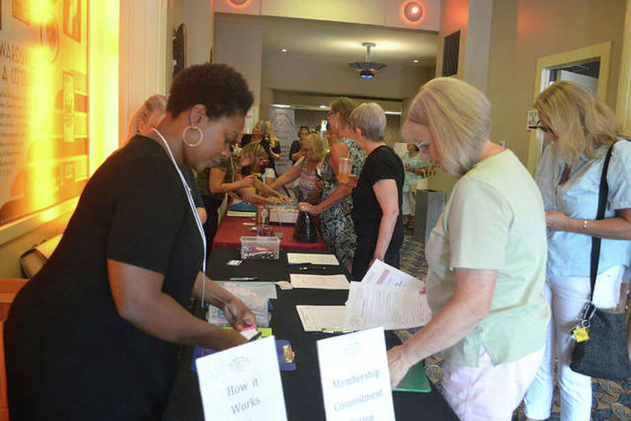 Women check in and pick up their member badges at the first quarterly Impact Award Meeting of 100+ Women Who Care from the 618, a new women's collective giving group. The group held its first quarterly meeting July 25 at The Wildey Theatre, in Edwardsville, Illinois. Photo: Scott Marion | Hearst Illinois