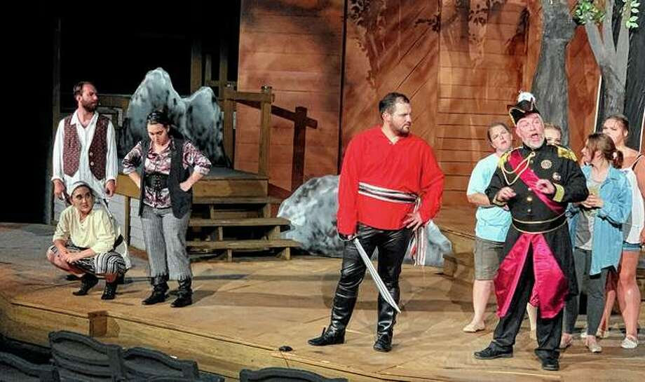 """Members of the cast of Gilbert and Sullivan's """"The Pirates of Penzance"""" rehearse a scene from the comic opera at Theatre in the Park at Lincoln's New Salem State Historic Site in Petersburg. The show's run continues at 8 p.m. today, Friday and Saturday. Tickets, which are $15 for adults, $13 for seniors and $10 for children, are available online at theatreinthepark.net or by calling 217-632-5440. Photo: Photo Provided"""
