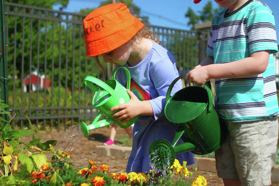 Kids learned about monarch butterflies Wednesday during Kids' Garden Club at Jacksonville Public Library. The program runs on Wednesdays from May through August and is in its ninth year. Photo: Rosalind Essig | Journal-Courier