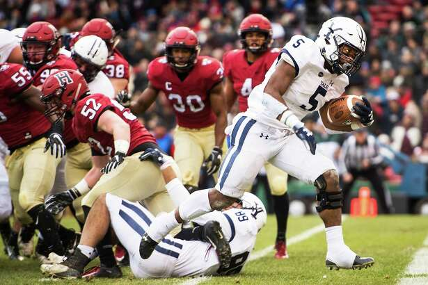 Yale running back Alan Lamar scores a touchdown during a game against Harvard at Fenway Park on Nov. 17, 2018 in Boston.