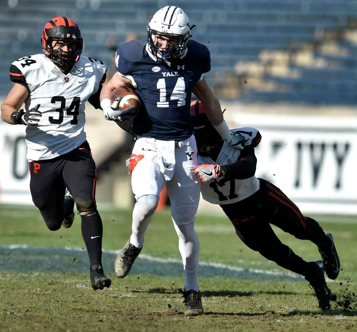 Reed Klubnik of Yale runs after a pass reception while pursued by Tom Johnson, left, and Delan Stallworth of Princetonon Nov. 10, 2018 at Yale Bowl.