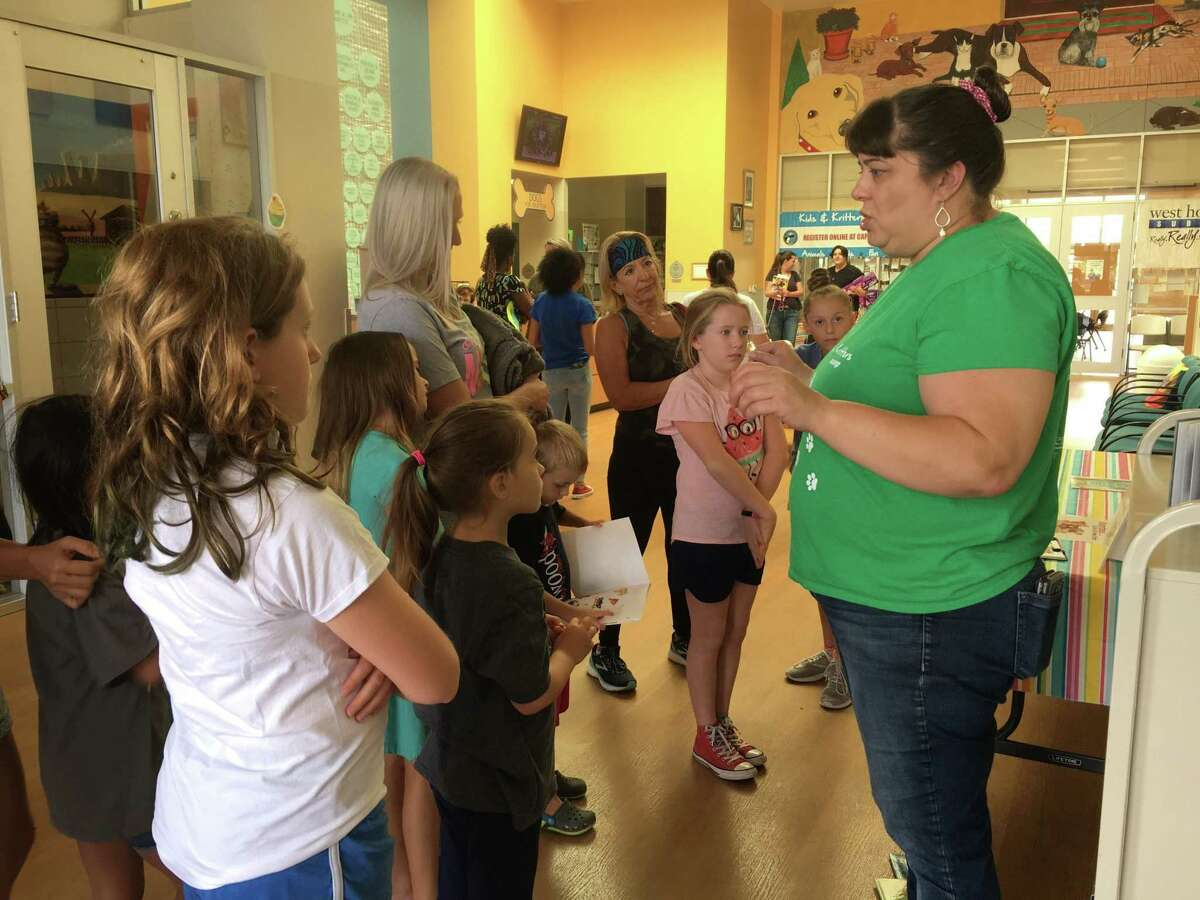 Ana Rodriguez, humane education coordinator, Citizens for Animal Protection, talks about Storytime with members of Let It Shine.