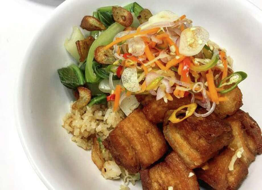 Filipino food such as this pork belly dish called lechon kawali will be the focus of a month-long pop-up at Pinch Boil House and Bia Bar beginning Aug. 12. Photo: Pinch Boil House And Bia Bar