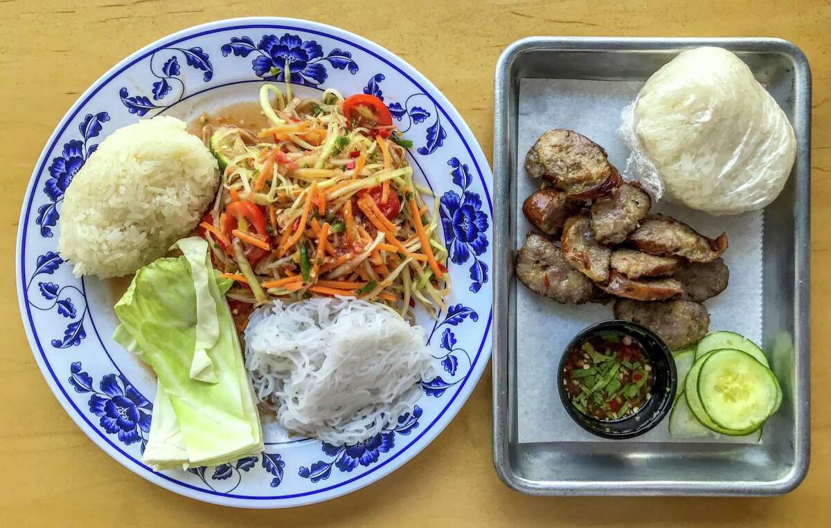 Papaya salad and Laotian sausage was served during one week of a pop-up at Pinch Boil House featuring Laotian food in July.